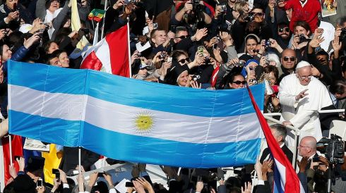 Pope Francis passes an Argentine flag as he arrives in Saint Peter's Square for his inaugural mass at the Vatican.  Photograph: Tony Gentile/Reuters