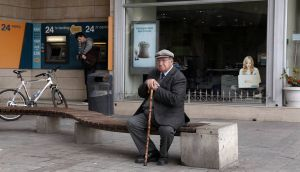 "An elderly man sits in front of a closed branch of Bank of Cyprus as a youth makes a transaction at an ATM in Nicosia today. Labour MEP Nessa Childers described as a ""terrible mistake"" a bailout deal which includes small Cypriot depositors. Photograph: Yorgos Karahalis/Reuters."