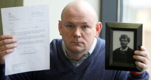 Charlie Agnew, nephew of John Pat Cunningham, 27, with a MOD apology and picture of Mr Cunningham at a press conference in Belfast today. Photograph: Paul Faith/PA Wire