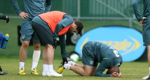 Walters in pain after a collision with Shane Long at Gannon Park. Photograph: Donall Farmer/Inpho