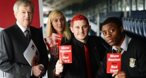 At the launch of Show Racism the Red Card at Croke Park today were Padraic Duffy GAA director general with Greta Perevalovaite and Rafael Mamba of Blakestown Community School and Eoin Mc Cafferty of Show Racism the Red Card organisation. Photograph: Cyril Byrne / The Irish Times