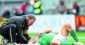 Luke Marshall lies injured in Rome. Photograph: Inpho/James Crombie