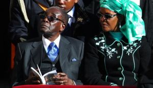 Zimbabwean president Robert Mugabe and his wife, Grace, attending the inauguration Mass for Pope Francis in St Peter's Square  in Vatican City yesterday. Photograph: Peter Macdiarmid/Getty Images