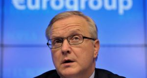 European Economic and Monetary Affairs Commissioner Olli Rehn: a spokesman  said that while EU law guarantees deposits of up to ¤100,000 per customer, per bank, this is only in the event of a bank failure. Photograph: Eric Vidal/Reuters