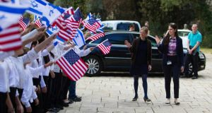 Israeli schoolchildren rehearse holding  the Israeli and US flags as two women stand in for US president Barack Obama and Israeli counterpart Shimon Peres yesterday. Photograph: Baz Ratner/Reuters