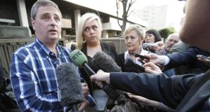 Andrew Furlong with  his wife Angela and their daughter Andrea speaking to reporters outside Tokyo district court yesterday. Photograph: Koji Sasahara/AP