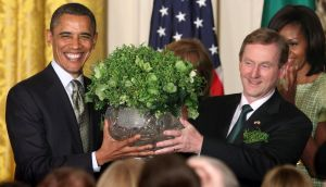 US president Barack Obama receives a bowl of shamrock from Taoiseach Enda Kenny during last night's St Patrick's Day reception at the White House. Photograph: Chris Kleponis/Reuters