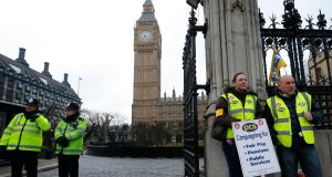 Striking members of the Public and Commercial Services Union (PCS) picket the Houses of Parliament in London, where British finance minister George Osborne faces the  task  of delivering another austerity budget. Photograph: Reuters/Andrew Winning.