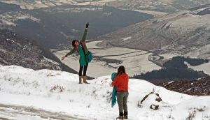 Tourists enjoying the latest snowfall at Sally Gap, Co Wicklow, yesterday.