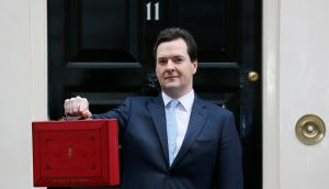 Britain's Chancellor of the Exchequer, George Osborne, holds up his budget case for the cameras as he stands outside number 11 Downing Street, before delivering his budget to the House of Commons. Photograph: Stefan Wermuth/Reuters.