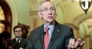 Senate majority leader Harry Reid speaks to the press after the weekly Senate Democrats policy luncheon yesterday in  Washington, DC. Photograph: Getty