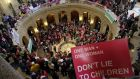 Opponents of a bill to legalise gay marriage in Minnesota gathered in the State Capitol, Rotunda, to voice their opposition. Photograph: AP/Jim Mone