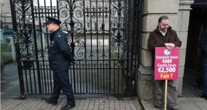 PJ Stone, general secretary of the Garda Representative Association protesting against propsed cuts in pay outside Leinster House today. Photograph: Dara Mac Dónaill/The Irish Times