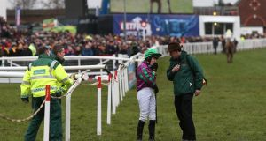Jockey Jane Mangan after being unseated by  her ride  Oscar Delta in the Foxhunter Chase at Cheltenham.
