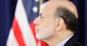 Federal Reserve Board Chairman Ben Bernanke attends a news conference at the Federal Reserve offices in Washington.