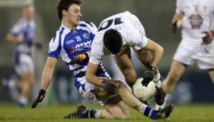 Laois's Shane Murphy tussles with Kildare's Liam McGovern during last night's Leinster U-21 clash at Parnell Park. Photograph: James Crombie/Inpho