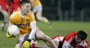 Antrim's Brendan Bradley and Derry's Gareth McKinless.