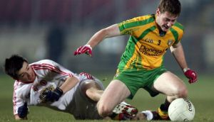 Ciaran Cannon of Donegal and Ronan O'Neill of Tyrone. Photograph: Inpho