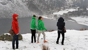 Tourists enjoying the latest snowfall, at Luggala, Co Wicklow last Tuesday.  Photograph: Eric Luke / The Irish Times.