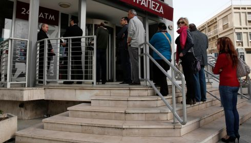 "People queue up to make a transaction at an ATM outside a branch of Laiki Bank in Nicosia as Cypriot politicians search desperately for a ""Plan B"" to find billions of euros to clinch a European Union bailout and avert a financial meltdown after parliament rejected a bank deposit levy.   Photograph: Yorgos Karahalis/Reuters"