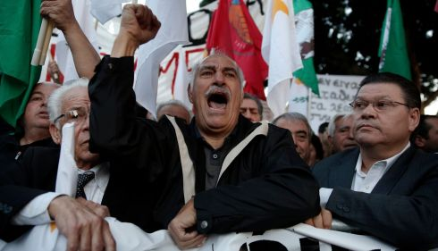 Protesters shout slogans during an anti-bailout rally outside the parliament in Nicosia. Photograph: Yorgos Karahalis/Reuters