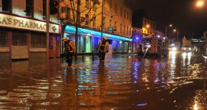 Emergency services on the scene of serious floods last night in Blackpool, Cork. Photograph: Michael Mac Sweeney/Provision