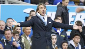 Manchester City manager Roberto Mancini reacts on the touchline during the Barclays Premier League match at Goodison Park. Peter Byrne/PA Wire.