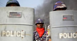 Policemen are deployed to provide security amid riots in Meikhtila. Unrest between Buddhists and Muslims in central Myanmar has reduced neighbourhoods to ashes and stoked fears that last year's sectarian bloodshed is spreading into the country's heartland in a test of Asia's newest democracy. Photgraph: Soe Zeya Tun/Reuters