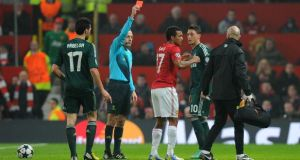 Manchester United's Nani is sent off by Turkish referee Cuneyt Cakir during the Champions League match against Real Madrid at Old Trafford. Photograph: Martin Rickett/PA