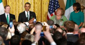 Taoiseach Enda Kenny, US president Barack Obama, Fionnuala O'Kelly and Michelle Obama share the stage during a St Patrick's Day reception at the White House in Washington on Tuesday.