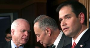 From left: Senators  John McCain, Chuck Schumer  and Marco Rubio are among a group of eight  working to devise an overhaul of immigration law.  Photograph: Doug Mills/the New York Times