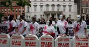 A protest outside the Dáil in 2006, organised by Amnesty International and Oxfam Ireland. Photograph: Eric Luke