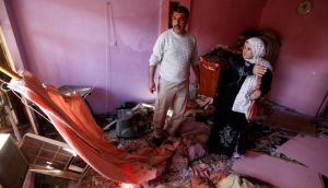 Iraqis examine damage inflicted on their house by a car bomb attack in AL-Mashtal district in Baghdad last Tuesday. Car bombs and a suicide blast hit Shi'ite districts of Baghdad and south of Iraq's capital, killing at least 50 people on the 10th anniversary of the invasion that ousted Saddam Hussein. REUTERS/Mohammed Ameen