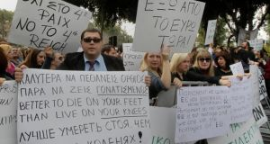Protesters taking part yesterday in an anti-bailout rally by employees of Cyprus Popular Bank outside the parliament in Nicosia. Photograph: Andreas Manolis/Reuters