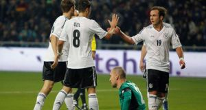Germany's  players celebrate next to the dejected Kazakhstan goalkeeper Andrei Sidelnikov. Photograph: Shamil Zhumatov/Reuters
