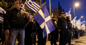 Supporters of the extreme-right Golden Dawn party hold Greek flags during a rally over the crisis in Cyprus outside the German embassy in Athens today.  Photograph: John Kolesidis/Reuters