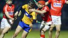Nicky O'Connell of Clare with Stephen Moylan of Cork during their NHL game, the result of which   left Jimmy Barry-Murphy disappointed. Photograph: Inpho