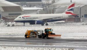 A snow plough clears the runway at Belfast City airport today. Photograph: Cathal McNaughton/Reuters