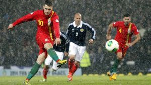 Wales' Aaron Ramsey scores from the penalty spot at Hampden Park.