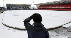 A groundsman looks at the Windsor Park pitch after Northern Ireland's World Cup qualifier against Russia was postponed. Photograph: Paul Faith/PA