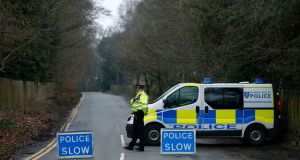 A police cordon blocks the road that leads to Russian oligarch Boris Berezovsky's house, after he was found dead yesterday at his home near Ascot in Berkshire. Photograph: Olivia Harris/Reuters