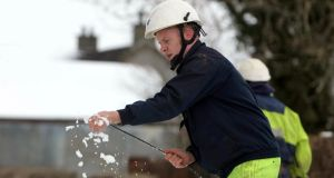 Crews making emergency repairs to the electricity network after fierce snow storms in Northern Ireland disrupted services. Photograph: PA