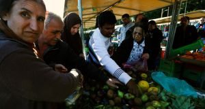 People buy leftover cheap groceries at an open air market in Nicosia yesterday. Cypriots were looking for cheap produce as banks have been closed for five days, cutting off funds for many. Photograph: Reuters