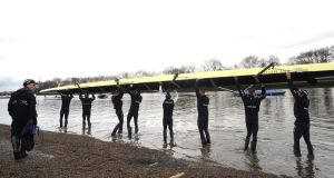 The Oxford crew get ready for a training session  ahead of the University  Boat Race against Cambridge. Photograph: Tom Dulat/Getty Images