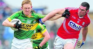 Kerry's Colm Cooper tries to evade the challenge of Cork's Noel O'Leary during the Division One clash at Austin Stack Park in Tralee. Photograph: James Crombie/Inpho