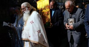Cypriots gather for Mass at an Orthodox church in Nicosia yesterday. Talks between the the International Monetary Fund and European Union continued as the country sought to agree terms to a bailout for its ailing banking sector. Photograph: Milos Bicanski/Getty Images