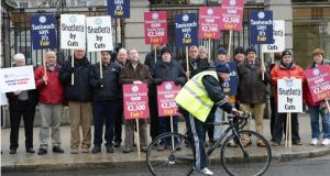 Members of the Garda representative bodies, GRA (Garda Representative Association) and Agsi (Association of Garda Sergents and Inspectors) protesting last week  against proposed cuts in pay under the new Croke Park agreement. Photograph: Dara Mac Dónaill