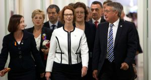 Australian prime minister Julia Gillard (C) walks with her supporters. She emphasised loyalty over experience when she named her new cabinet. Photogrph: Andrew Taylor/Reuters