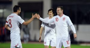 Wayne Rooney celebrates scoring England's sixth goal against San Marino