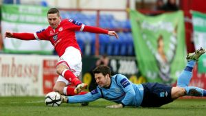 Shamrock Rovers' Barry Murphy gets a hand to the ball to foil Shelbourne's Dean Kelly at Tolka Park. Photograph: Donall Farmer/Inpho